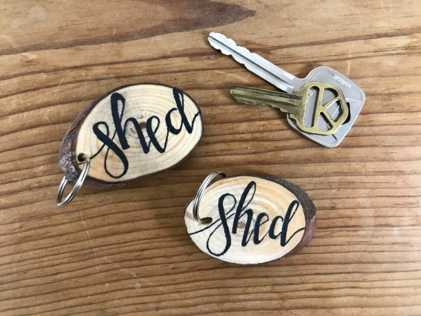 """Shed"" wood slice keychains"