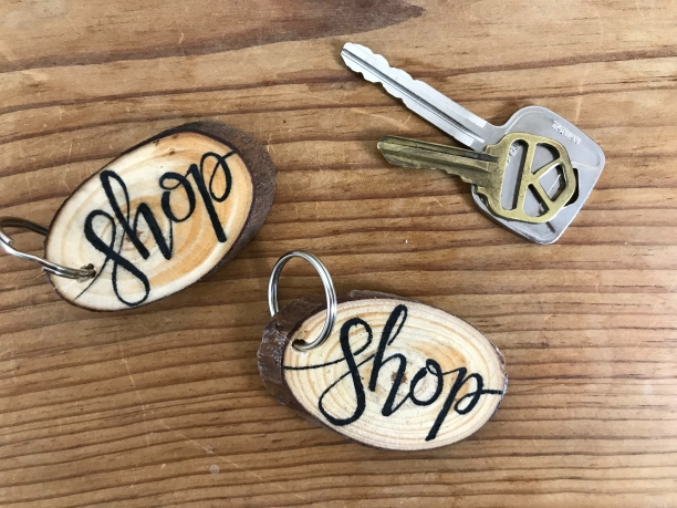 """Shop"" wood slice keychains"