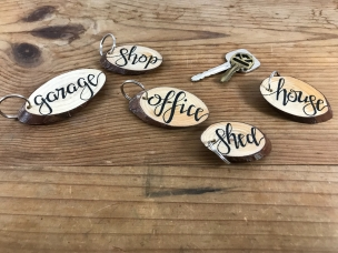 """Tag"" wood slice keychains"